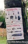 Poster identiying unexploded ordnance and landmines
